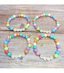Pulsera Letras doradas con bolas de colores